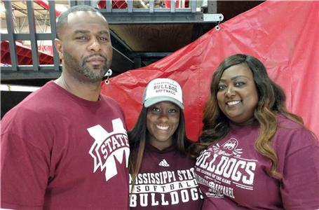 Ooltewah's standout softball pitcher Kayla Boseman, center, made her four-year commitment to Mississippi State official this week when she signed a SEC scholarship with the Lady Bulldogs. Boseman is flanked by her father, Robert, and mother, Felicia.