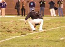 During a timeout, an official rushed out for some quick repair work on the battered field. <i>Click to enlarge photo.</i>