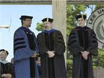 Faculty Excellence Award Winners (from left) Dr. Emerson Powery, Dr. Lee Cheek, and Dr. Johnny Evans stand together onstage at Lee's May 2004 Commencement ceremony. Click to enlarge.