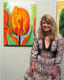 Bernadette Resha with one of her paintings