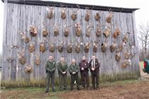 <i>TWRA officers Jereme Odom and Dale Grandstaff stand in front of the confiscated trophies. Also pictured are (from center to right) Kentucky Fish and Wildlife Resources Officers Ken Richards and U.S. Fish and Wildlife officers Jason Godwin and Jeremy Curtis.</i>