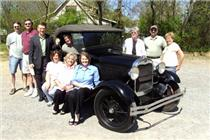 Pictured with a 1929 Ford Model A used in the movie Wild River are, from left, Scott Sanders, John Heifner, Dan Howell, David Swafford (in the car), Darlene Goins, Faye Callaway, Melissa Woody, Natalie Winningham, Brian Pierce (owner of the car) and Charlene Hayden. Lisa Simpson Lutts was not present for the photo.  Click to enlarge.