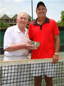 <b>Trophy Presentation - Fifty Years Later</b>: Zan Guerry (right) receives a national championship silver bowl from Tommy Bartlett on Court 1 at Manker Patten Tennis Club earlier this week. Fifty years ago this weekend, Guerry won the inaugural national 11s singles and doubles championships in July 1960 at Manker Patten as Bartlett was the tournament director.