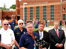 Don Allen speaks at press conference. Pictured from left to right, Chief Ken Wilkerson, Assistant Chief D. Thompson with Tri County Fire Department, Don Allen, Mayor Coppinger, Chester Bankston.
