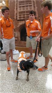 Smokey IX with student handlers at book signing.