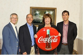 Celebration CEO Doyle Meadows, left, with representatives of the Tullahoma Coca-Cola bottling plant