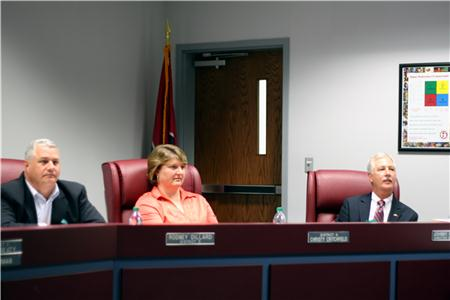 From left are board members Rodney Dillard and Christy Critchfield and School Director Johnny McDaniel