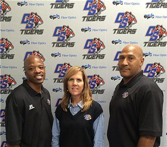 Chattanooga State Assistant Basketball Coach Travis Glover, Athletic Director Kim Smith and Head Basketball Coach Jay Price are shown with the new EPB/Chattanooga State sports conference backdrop.