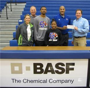 Jay Price, Chattanooga State Head Basketball Coach, accepts a $2,000 donation from BASF employees, along with members of the Tigers' basketball teams and athletic department. From left: Ashley Thompson, BASF process engineer; Greg Dennis, Chattanooga State head baseball coach; Brandon Shingles, Tiger basketball player; Teondra Crawford, Tiger basketball player; Jay Price and Robert Gagliano, BASF Chattanooga site manager.