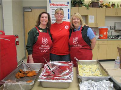Salvation Army volunteer, Cindy Hindmon, Salvation Army Director of Volunteer Services & Special Events Stacey Lynn Crisp, and Salvation Army volunteer, Shan Megison serving lunch to the displaced residents