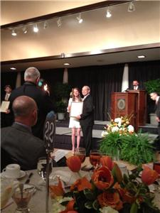 Paige Atchley with Chancellor Jimmy Cheek receiving her Torchbearer Award