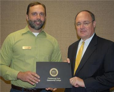 Keith Sanford, right, Market President of First Tennessee, presented the First Tennessee Chair of Excellence in Business and Information Technologies to faculty member Chris Willis.