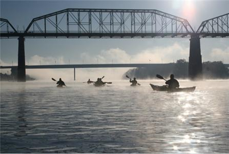 Kayakers speed along on the Tennessee River near Market Street bridge.