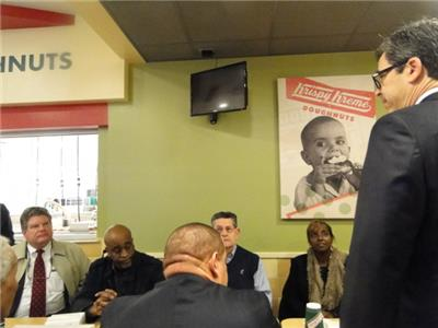 Mayor Andy Berke speaks with Brainerd residents at the Krispy Kreme on ways to curb check cashing businesses