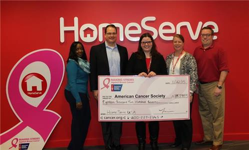 From left, Jackie Leach - Accounts Payable coordinator, HomeServe USA; Tom Rusin - CEO, HomeServe USA; Kristen Welton - community manager, American Cancer Society; Isobel Bonar - senior analyst, Compensation and Benefits, HomeServe USA and Michael Szarpa - senior analyst, Finance, HomeServe USA.