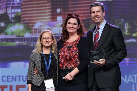 At the National League of Cities Congress of Cities event in Nashville, Chattanooga was selected as one of six winners of the inaugural Digital Inclusion Leadership Awards.  From left, Deb Socia, National League of Cities; Kelly McCarthy, Tech Goes Home Chattanooga and Mayor Andy Berke