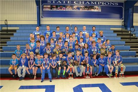 Cleveland's Higher Calling Kids Wrestling Club was the 2015 Tennessee AAU Middle State Champion and overall team champion for the second consecutive year. The team is pictured with its coaching staff.