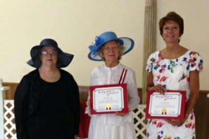 Receiving membership certificates, from left, President Marilyn Kinne, Harriet Caldwell (standing in for Carolyn Eubank) and Linda Ballew.