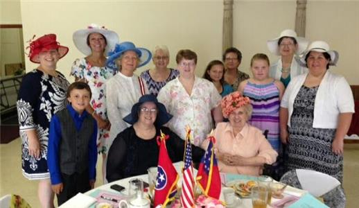 The United Daughters of the Confederacy Jefferson Davis Chapter at the annual June Tea.  Front row, from left, Marilyn Kinne and Margaret Biggs; second row, Garin Willard, Harriett Caldwell, Teresa Silvers, Ashley Allen and Melanie Johnson; and third row, Lisa Pritchett, Linda Ballew, Peggy Morrison, Maney Willard, Anita Green and  Gussie Ridgeway.  The children represent the Children of the Confederacy.