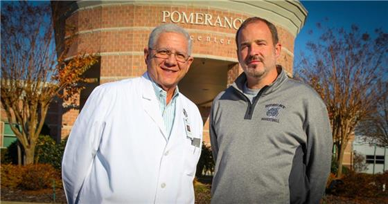 Dr. Glenn Pomerance, left, and Georgia Northwestern Technical College Athletic Director David Stephenson stop for a quick picture outside of the Pomerance Eye Center on Gunbarrel Road in Chattanooga. Dr. Pomerance has been a contributor to the GNTC Athletics programs for the past five years.