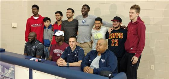Senior Abduhakim Ado, seated second from left, signed to play college basketball at Mississippi State on Thursday at the school on Hickory Valley Road. Ado was joined by seated from left, assistant Chris Walker, head coach Zach Ferrell and assistant Tre High and several classmates and teammates.