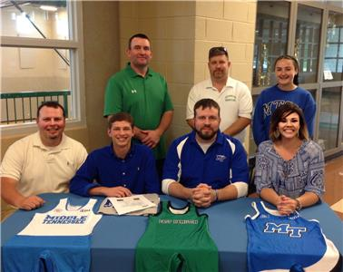 East Hamilton's Briar Potter, seated second from left, will wrestle at MTSU next year.  Joining the Hurricane senior for the memorable occasion was his father Sam (seated on far left), followed by MTSU assistant coach Troy Steffy and Briar's mother Danielle.  Those in the rear, from left to right, include East Hamilton head coach Ryan Cooper, assistant coach Jason Courtney and Shelbie Sholtz, one of Briar's sisters.