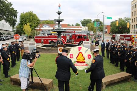 Members of the fire department's Honor Guard present a wreath to honor fallen firefighters at Monday morning's ceremony at the Fireman's Fountain to kick off Fire Prevention Week.