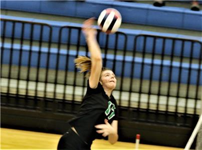 Emma Mitchell of East Hamilton powers a shot at the net during Tuesday's state volleyball tournament game against Sullivan South at Siegel High School in Murfreesboro. The Lady Canes beat Sullivan South, but later lost to Portland. They face Signal Mountain on Wednesday morning in an elimination game.