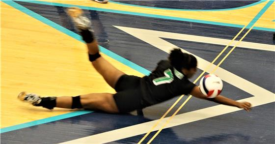 East Hamilton's Taryn Robinson lays out while attempting to keep a ball in play against Sullivan South in the Class AA state volleyball tournament on Tuesday. The Lady Hurricanes won the match 3-0.