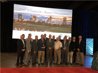 Brad Simmons (holding award) and members of LIFE FORCE at the Community Awards program during the Air Medical Transport Conference in Fort Worth, Texas.