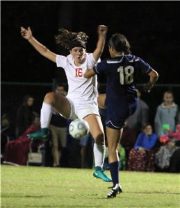 Signal Mountain's Lucy Calhoun tries to control the ball with CSAS's Isabella Poke plays defense.