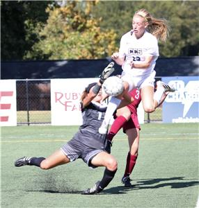 CCS's Sarah O'Shea goes for a ball as the USN keeper comes out to make a save.