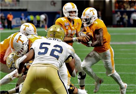 Tennessee running back John Kelly (4), a junior from Detroit, Mich., taking a handoff from quarterback Quinten Dormady against Georgia Tech, and teammate Will Ignont, a freshman from Nashville, were cited Tuesday night for drugs when drugs were found in their car at a traffic stop near campus.