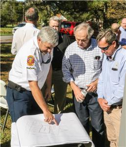 Whitfield County Fire Chief Ed O'Brien (from left), Cohutta Mayor Ron Shinnick, and County Commissioner Greg Jones look over plans for Fire Station 11, which is being paid for with $1.5 million of SPLOST funds.