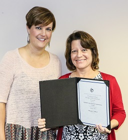 Whitfield County Finance Director Alicia Vaughn (left) congratulates Carol Roberts, accounting/budget analyst for the county, who is holding a Certificate of Recognition for Budget Presentation she received for her efforts from the Government Finance Officers Association. The county received the organization's Distinguished Budget Presentation Award for the sixth time since 2011.