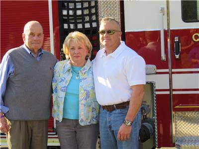 Mayor Tom Rowland, Sandra Rowland and Cleveland Fire Chief Ron Harrison with the Mayor Tom Rowland fire truck