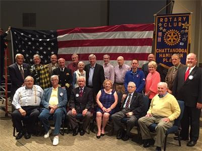 Pictured are club and guest veterans, along with Program Coordinator Rosanne Apyan (front row) and Club President Todd Gaither (back row, far right).  Captain McCamish is fourth from left on second row.
