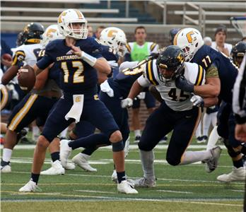 UTC's Cole Copeland rolls out looking downfield for a receiver Saturday afternoon in their 10-3 win over ETSU.