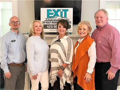 EXIT Realty McGowan & Associates.  From left, Tim Mazzolini, principal broker; Pat McGowan, owner/affiliate broker; Lisa Ellis, affiliate broker; Sheryl Phillips, affiliate broker; and Roby Phillips, affiliate broker.