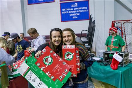 Lee students at the Pack N' Stack event packing boxes for Operation Christmas Child