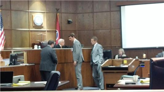 Attorneys discuss case with Judge Don Poole