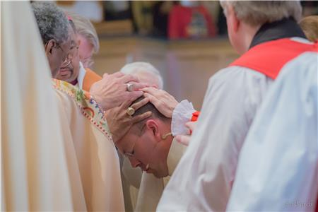 Bishops lay hands on the Rt. Rev. Brian Cole to ordain and consecrate him Dec. 2 as the new bishop of the Episcopal Diocese of East Tennessee at Church of the Ascension in Knoxville