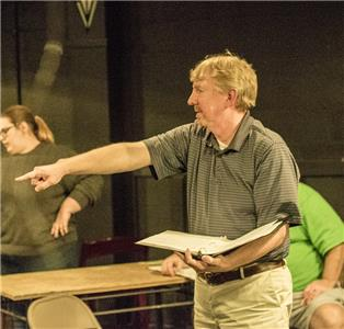 "Thomas White directs actors during a rehearsal of ""Irish Courage"""