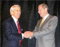 Tom Edd Wilson accepts CAMOY Award from Mayor Ron Littlefield in 2006