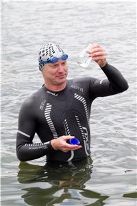 "Dr. Andreas Fath collects a water sample during his world-record breaking swim of the Rhine River. He will attempt a similar ""swim for science"" along the Tennessee River's 652-mile length beginning July 27."