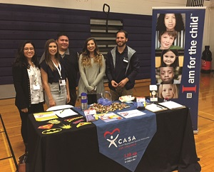 Pictured: Representatives from CASA (Court Appointed Special Advocates) of Bradley and Polk Counties attended the expo to tell students about the various volunteer opportunities with CASA. (From left to right) Michelle Quintero, social worker; Mackenzie Tatum, social worker; Ralf Santiago, case manager; Marisa Gilbert, vista; Chris Janetzko, outreach manager.