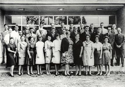Pictured in the photo taken in 1967 of the original faculty, front row from left are: Edna Stripling, Jane Secord, Nancy Powell, Betty Perry, Betty Gallant, Donna Bentley, Theresa Krebs, Eileen Fitzgerald, Ruth Miller, Anna Elkins, and Margaret Hunnicutt; second row from left are: Bob Brown, E.G. Bain Johnson, Terry Christie, Dr. Clyde Bushnell, Melvyn Ottinger, Harris Mynatt, Joey Mayson, Ben Tate, Mickey Sutton, Harlan Chapman, and Bill Brooks; third row from left are Tommy Roy, Arthur Little, Emory Grant, Michael Moorhead, Arvine Phelps, Dr. Ed Mobley, Dr. Ben Wygal, David Clements, Dr. Bob Cline, Joel Braswell, and Dr. Arthur Gignilliat.