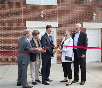 At the ribbon cutting, from left, Dennis Livingston, Darlia Conn, Dr. Paul Conn, Dr. Carolyn Dirksen, and Dr. Murl Dirksen