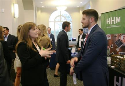 Lee student Emily Holden, left, speaks with Lee alumnus Kyle Briner from the firm Henderson, Hutcherson & McCullough