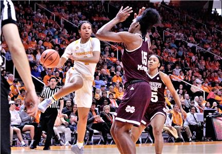 Tennessee's Evina Westbrook (2) brings the ball into the lane against the defense of Mississippi State's Teaira McCowan during the Lady Vols' loss to the Bulldogs, 71-52, Sunday afternoon in Knoxville.